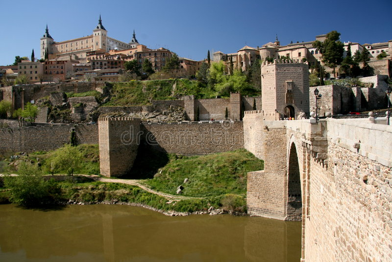 Historic bridge and city. Historic medieval city and bridge leading to it royalty free stock photos