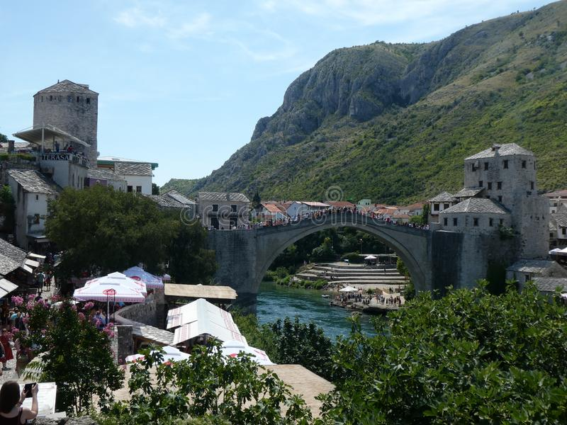 Historic bridge close to the mountain. Historic old bridge Stari Most on the river, close to the mountain. Historic city in Bosnia Herzegovina. Re-building after royalty free stock images
