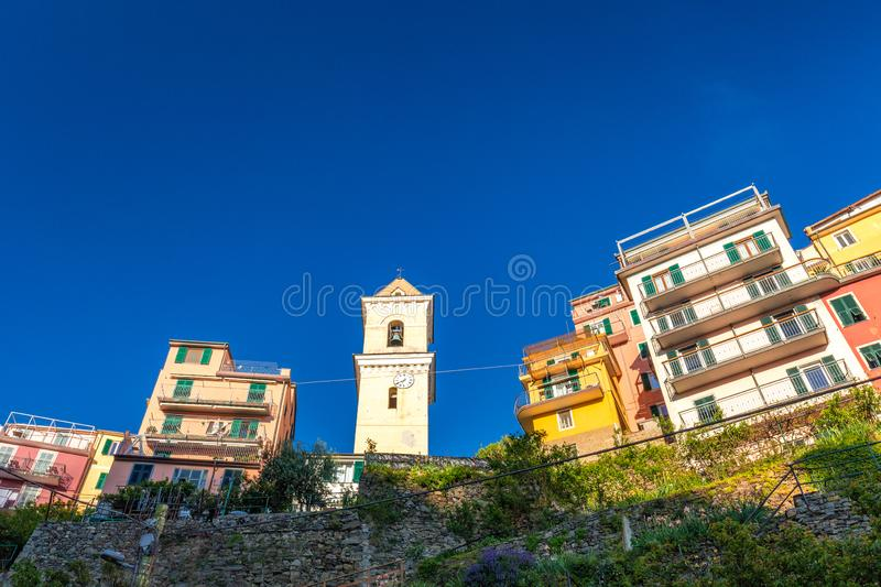 Historic building with bell tower in Manarola stock image