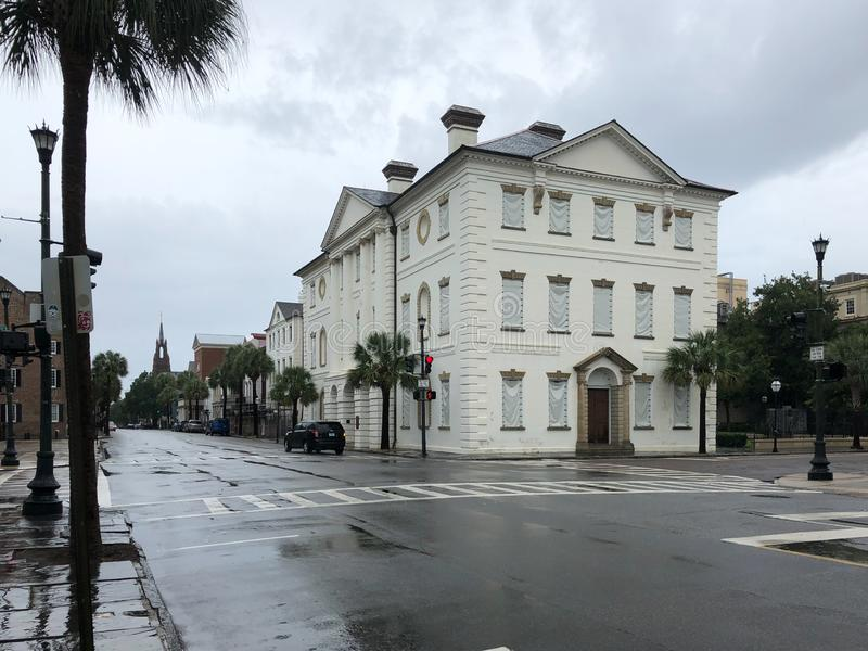 Broad Street in Charleston, SC awaits the arrival of Hurricane Dorian. Historic building on Broad Street in downtown Charleston, South Carolina are boarded up to stock photos