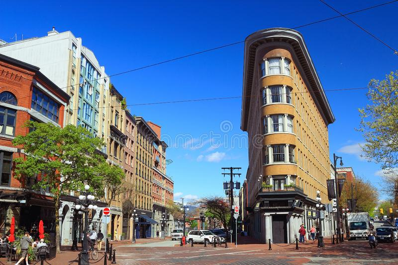 Gastown in Vancouver on a sunny Spring Day, British Columbia, Canada. Historic Buildings at the intersection of Alexander and Powell Streets with Water and stock images
