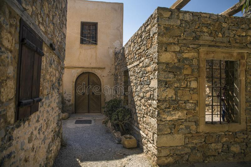 Historic buildings on the island in the fortress of Spinalonga in Crete. Boat trip to the island of lepers stock image