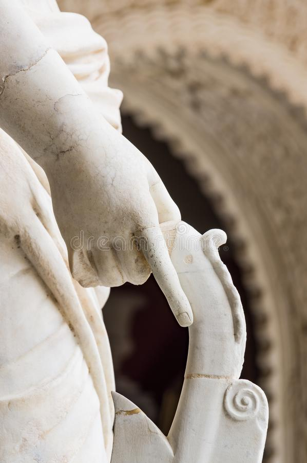 Historic buildings and monuments of Seville, Spain. hands. Statue. Marble. Historic buildings and monuments of Seville, Spain. Architectural details, stone stock images