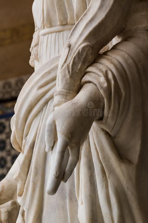 Historic buildings and monuments of Seville, Spain. hands. Statue. Marble. Historic buildings and monuments of Seville, Spain. Architectural details, stone royalty free stock photos
