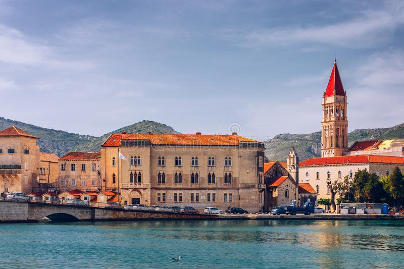 Historic buildings on promenade in Trogir, Croatia. Trogir is popular travel destination in Croatia. Trogir, as a UNESCO World. Heritage Site, is one of most stock photos