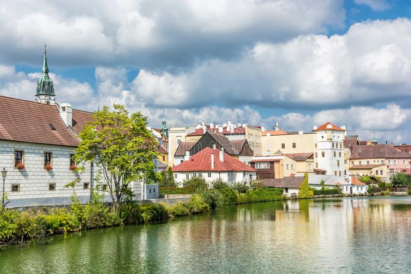 Historic buildings with reflections in water reservoir, Jindrichuv Hradec. Czech republic. Architectural scene. Travel destination royalty free stock images
