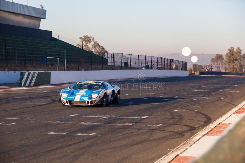 A classic racing car races around Kyalami race track stock photos