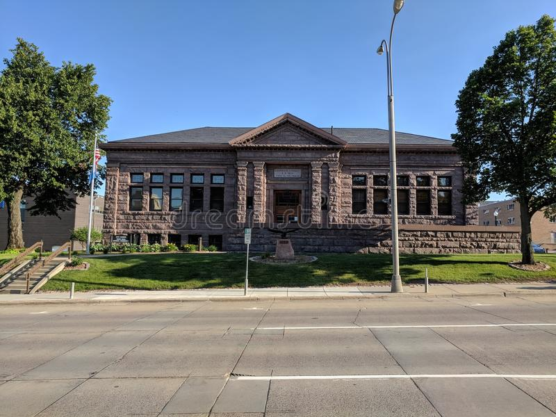 The Historic Carnegie Library Landmark is Sioux Falls& x27; Town Hall. The Carnegie Town Hall features construction from the local quartzite stone and houses the stock image