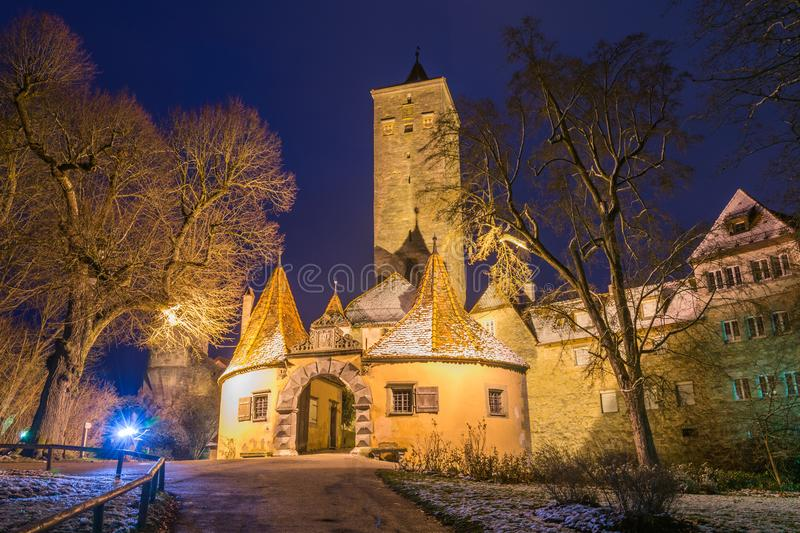 The historic castle gate and tower in Rothenburg ob der Tauber,. The lit historic castle gate and tower in Rothenburg ob der Tauber, Germany at night stock images
