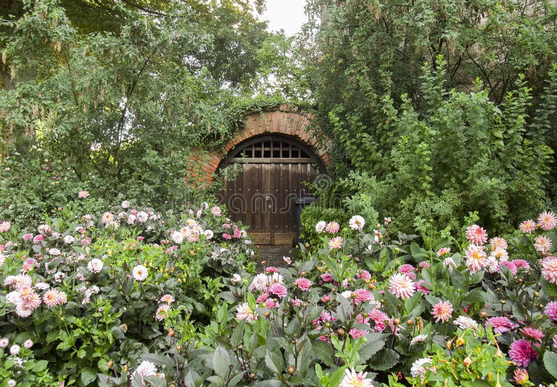 Historic cellar entrance. Surrounded by flowers and other vegetation royalty free stock images