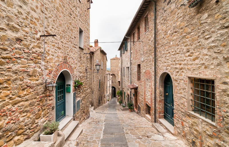 Historic center of Castiglione della Pescaia, Tuscany, Italy. The narrow street in the historic center of Castiglione della Pescaia, Tuscany, Italy royalty free stock photos
