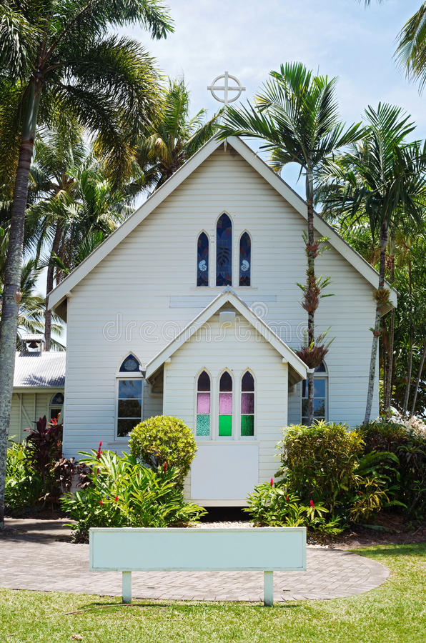 Historic Chapel Exterior at Port Douglas. Historic white chapel of gothic revival style on shores of coral sea in tropical port douglas queensland australia royalty free stock photos