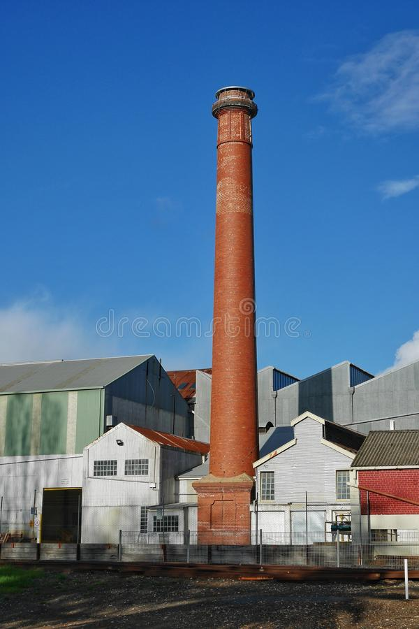 Historic chimney and factory buildings at Thompson Kelly and Lewis engineering facility in Castlemaine, Victoria, Australia royalty free stock image
