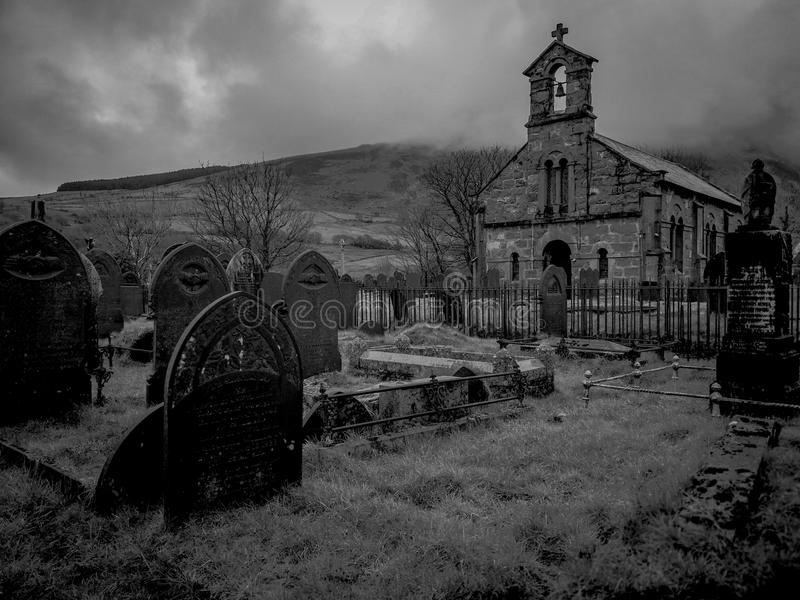 Welsh church and cemetery foggy black and white royalty free stock photos