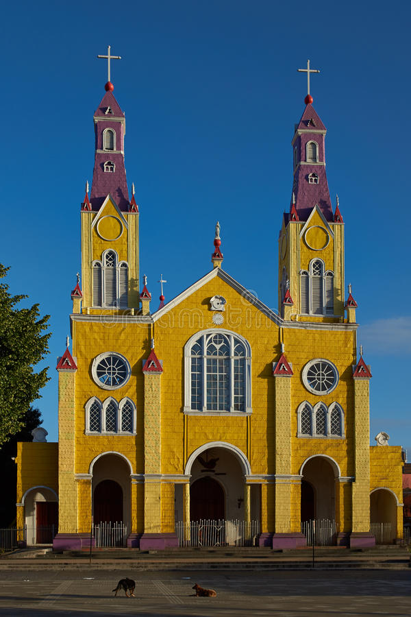 Historic Church of Chiloé. Bright yellow and purple painted facade of the historic Iglesia San Francisco in Castro, capital of the island of Chiloé in royalty free stock photos