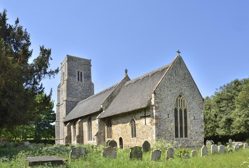Historic Church and Graveyard of East Anglia. View of the medieval Church of All Saints, with surrounding graveyard, Thurlton, South Norfolk, England royalty free stock images