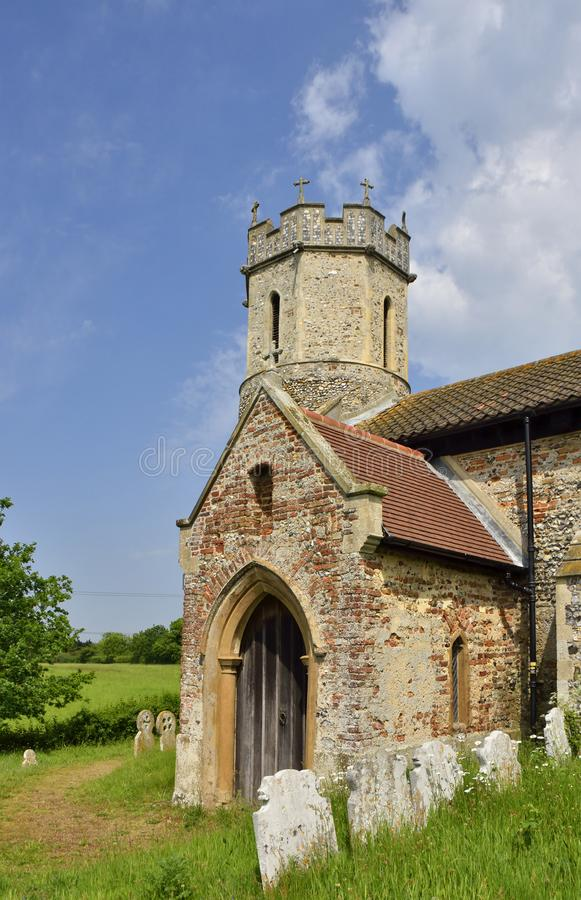 Historic Church and Graveyard of East Anglia. View of the porch and tower of the historic church of St. Mary, Hassingham, South Norfolk, England stock images