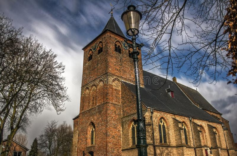 Historic Church in Westervoort. Historic Church in the village of Westervoort in HDR royalty free stock photo