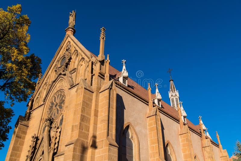 Historic church in warm evening light under a vivid blue sky in Santa Fe, New Mexico. Old gothic style church in warm evening light under a vivid blue sky in royalty free stock photo