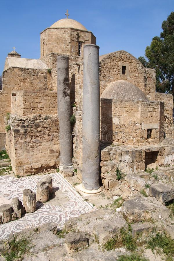 The historic church of yia Kyriaki Chrysopolitissa in paphos cyprus showing the building and the surrounding old roman columns and. Ruins royalty free stock photo
