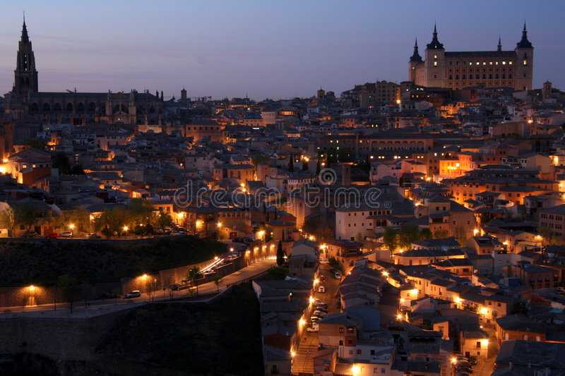 Historic city around dusk. Historic and medieval city with lots of lights during dusk hour stock photo