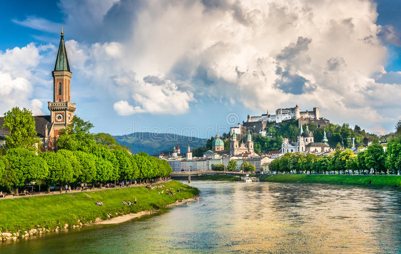 Historic city of Salzburg with dramatic clouds in summer, Austria. Beautiful view of Salzburg skyline with Festung Hohensalzburg and Salzach river in summer royalty free stock photo