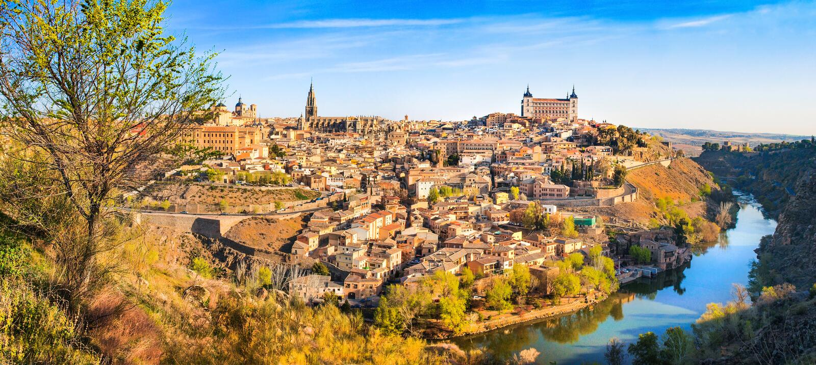 Historic city of Toledo with river Tajo at sunset, Castile-La Mancha, Spain stock images