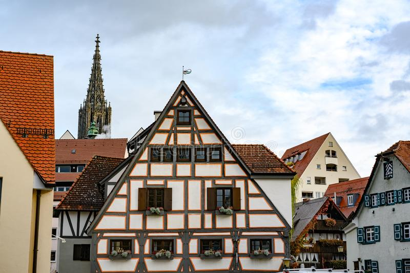 Historic city of Ulm with spire of Ulm Minster, Baden-Wuerttemberg, Germany. Half-timber houses in historic district of Ulm. royalty free stock photo