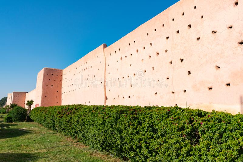 City Walls in Marrakesh Morocco. The historic city walls with green bushes and plants in Marrakesh Morocco royalty free stock photo