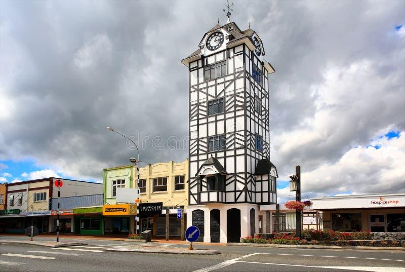 Historic clock tower of Stratford near volcano Taranaki, New Zealand. Grey cloudy sky background royalty free stock photo