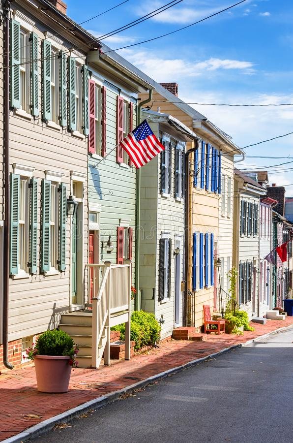 Historic Wooden Row Houses with Colourful Shutters and Blue Sky royalty free stock photo