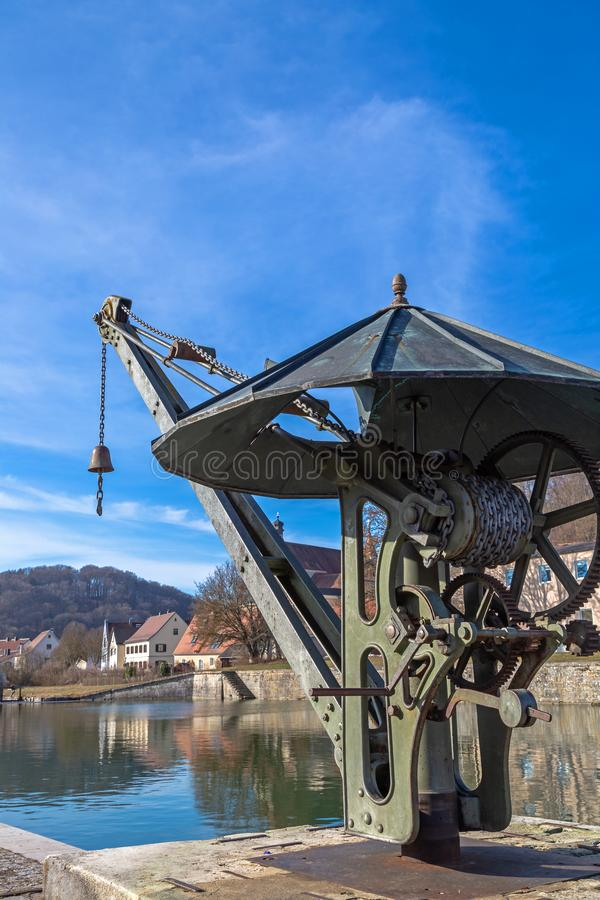 Historic crane at Old Port of the Ludwig Danube Main Canal in Kelheim. Bavaria, Germany royalty free stock photography
