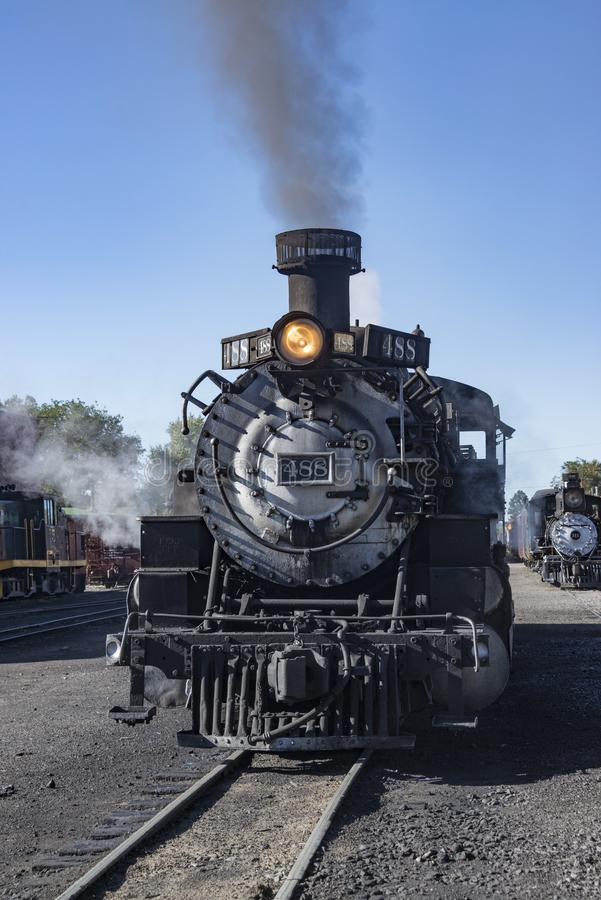 Historic Cumbres Toltec narrow-gauge train steam engine in Chama, New Mexico station stock images