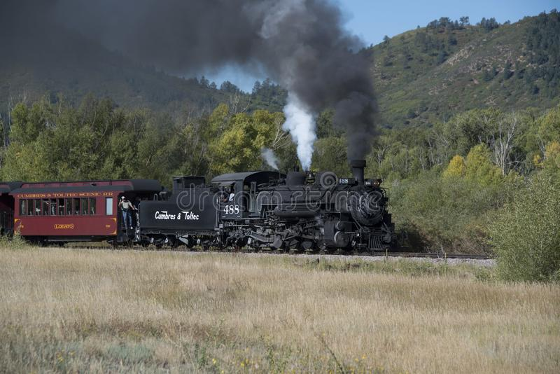 Historic Cumbres Toltec narrow-gauge train steam engine enroute to Antonito, Colorado train station royalty free stock photography