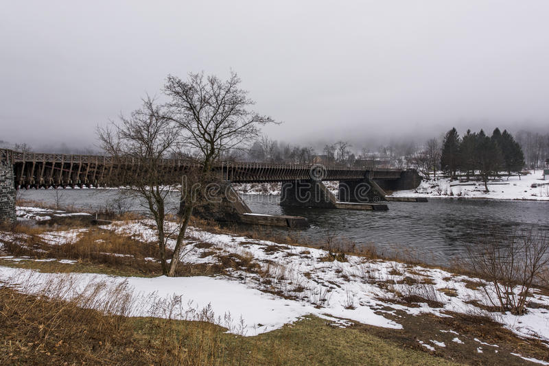 Historic Delaware Aqueduct - Delaware and Hudson Canal Heritage Site. A snowy, winter scene of the Roebling designed Delaware Aqueduct along there former royalty free stock image