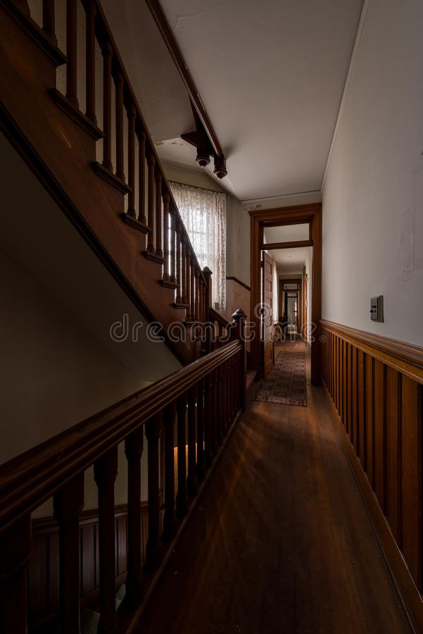 Historic & Derelict Rectory with Staircase and Wood Paneling - Abandoned St. Peter Catholic Church - Troy, New York stock photo