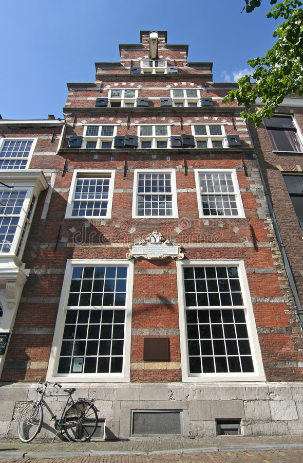 Historic Dutch House. With'step' gable and bicycle parked in front royalty free stock photos