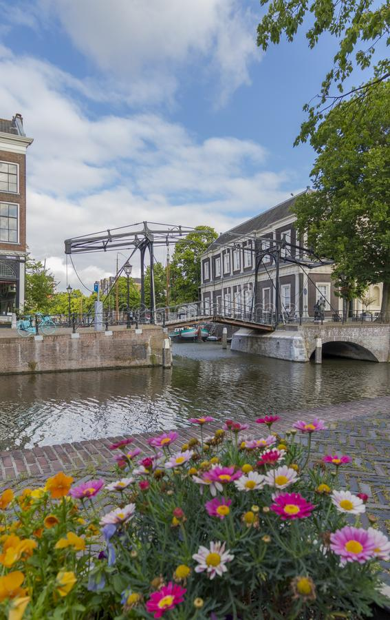 Historic Dutch lift bridge in Schiedam, The Netherlands. Colorful image of historic canals and lift bridge, Lange Haven in Schiedam, The Netherlands stock image