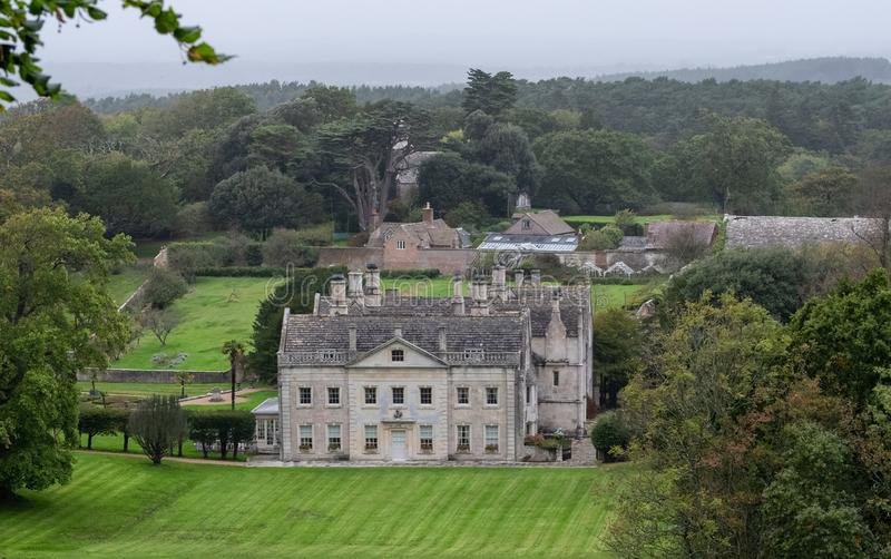 Historic English country house Creech Grange in Steeple near Wareham in the county of Dorset, photographed from Grange Hill. The Purbeck Hills can be seen in stock photo