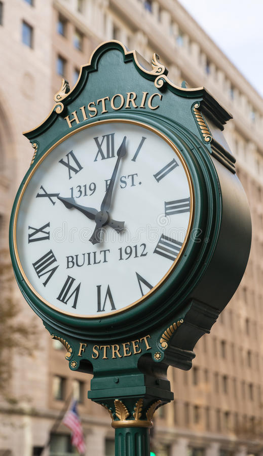 Historic F Street Clock in Washington DC royalty free stock images