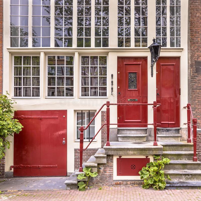 Free Historic Facade Of Amsterdam Canal House Stock Photo - 136523250