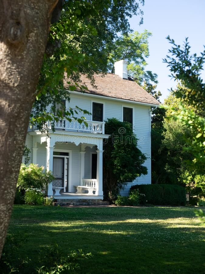 Historic farm house. The historic Hanley Farm house in southern Oregon is surrounded by large trees and green lawn stock photography