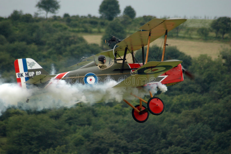 Historic fighter plane. With smoke trail from engine royalty free stock image