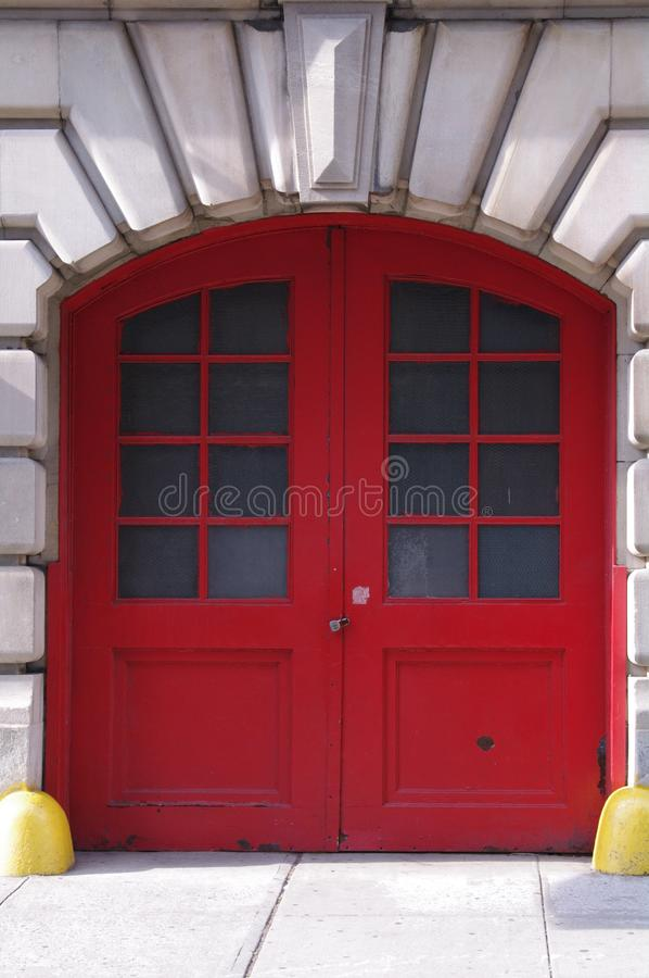 Red Fire House Doors. Historic fire house doors, at one home to horse drawn fire wagon stock images