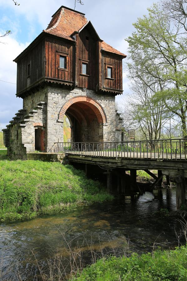 Historic gate house of the Castle Krobielowice in Silesia, Poland. The wonderful and historic gate house with brook of the Castle Krobielowice in Silesia, Region stock photo