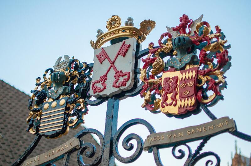 Historic gate to the city of Leiden, The Netherlands. With beautifully crafted shields and symbols royalty free stock photo