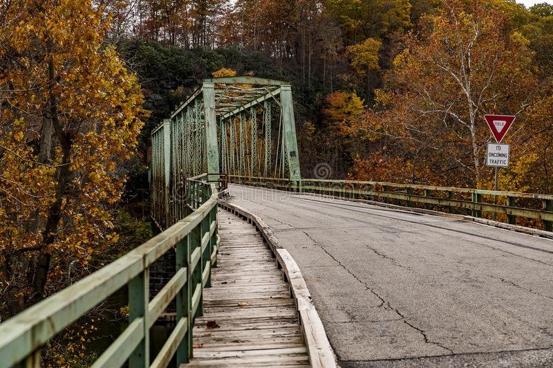 Historic Green Truss Bridge in Autumn - Layton Bridge - Fayette County, Pennsylvania. A view of the historic, narrow, one lane green truss Layton Bridge on an stock image