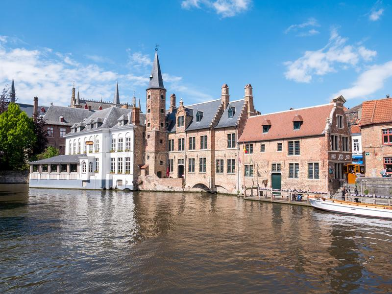 Historic guildhall of tanners and hotel along Dijver canal in Bruges, Belgium. Historic guildhall of tanners and hotel along Dijver canal in old town of Bruges stock photos