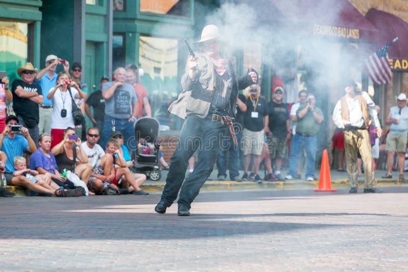 Historic Gunfight Reenactment. DEADWOOD, SD - AUGUST 26: Reenactment of a gunfight in Deadwood, SD on August 26, 2015 stock photos