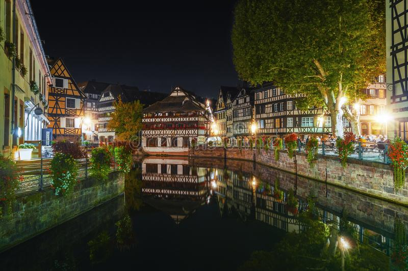 Historic half-timbered houses in tanners quarter in district la petite france in Strasbourg at night stock image